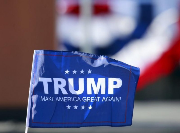 FILE - A flag supporting U.S. Republican presidential candidate Donald Trump flag is seen at his rally at Madison City Schools Stadium in Madison, Alabama February 28, 2016. REUTERS/Marvin Gentry