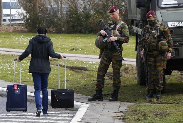 Belgian soldiers control the access to Belgian international airport of Zaventem airport, which is still not operating, more than a week after the attacks in Brussels metro and the airport, in Zaventem, Belgium, April 1, 2016.   REUTERS/Yves Herman
