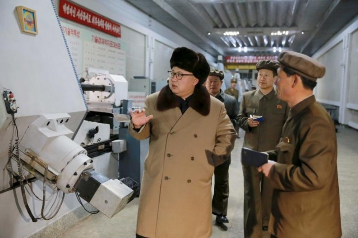 North Korean leader Kim Jong Un (L) gives field guidance during a visit to the Tonghungsan Machine Plant under the Ryongsong Machine Complex in this undated photo released by North Korea's Korean Central News Agency (KCNA) on April 2, 2016.  REUTERS/KCNA