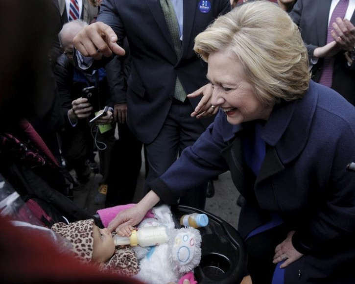 U.S. Democratic presidential candidate Hillary Clinton is greeted by a supporter with a baby during a campaign stop on the street in the Bronx borough of New York, April 7, 2016. REUTERS/Brendan McDermid
