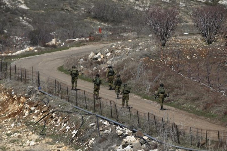 Israeli soldiers walk towards the border with Syria, near the Druze village of Majdal Shams in the Golan Heights February 18, 2016. REUTERS/Baz Ratner