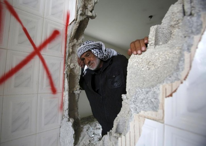 FILE - A Palestinian man reacts as he checks the damage to the home of Palestinian Mohammed al-Haroub after it was partially demolished by Israeli army in the West Bank village of Dir Samt, south of Hebron February 23, 2016. Reuters