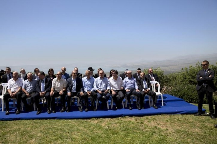 Israeli Prime Minister Benjamin Netanyahu (5th L, front row) poses with ministers prior to the weekly cabinet meeting in the Israeli occupied Golan Heights near the ceasefire line between Israel and Syria, April 17, 2016. REUTERS/Sebastian Scheiner/Pool