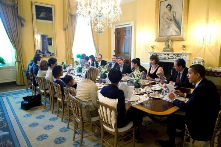 FILE - U.S. President Barack Obama and Michelle Obama host a Passover Seder Dinner with friends and staff  in the Old Family Dining Room at the White House in Washington, in this handout photograph taken on April 2009 and later released by the White House. Photo resolution is the maximum available from source.  REUTERS/Pete Souza/The White House/Handout