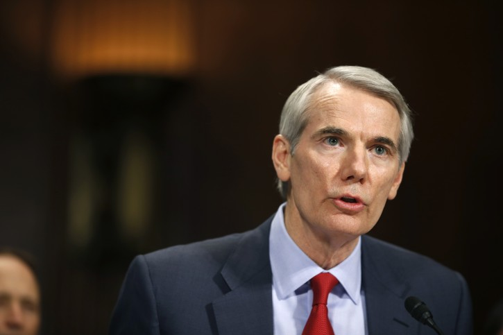 FILE - In this Jan. 27, 2016 file photo, Sen. Rob Portman, R-Ohio testifies on Capitol Hill. For months Donald Trump has dominated the political scene like no other. But listen to endangered Senate Republicans as they campaign for re-election and you might not even know he exists.  (AP Photo/Alex Brandon, File)