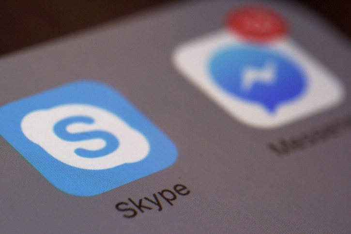 "This Saturday, April 9, 2016 photo shows the icons for Microsoft's Skype and Facebook's Messenger apps on a smartphone in New York. In coming months, people who use Messenger, Skype and Canada's Kik for online chats can expect to see all kinds of businesses offering information and other services with the help of messaging ""bots,"" or software that's capable of human-like conversation. (AP Photo/Patrick Sison)"