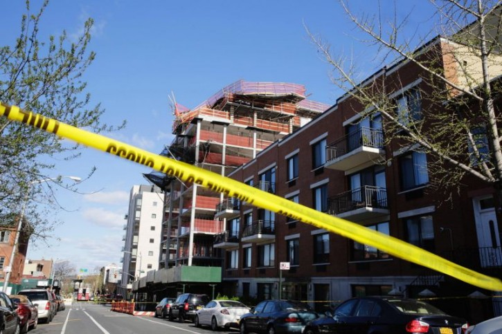 High winds caused the collapse of scaffolding on a building under construction Sunday, April 3, 2016, in the Brooklyn borough of New York. (AP Photo/Peter Morgan)