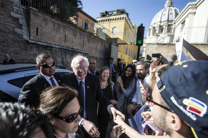 US Democrats presidential candidate Bernie Sanders (C) leaves the Vatican after the conference commemorating the 25th anniversary of 'Centesimus Annus', a high-level teaching document by Pope John Paul II on the economy and social justice at the end of the Cold War, at the Vatican City, 15 April 2016.  EPA/ANGELO CARCONI