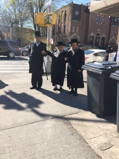 The Karlsburger Rov, Rabbi Yechezkel Roth seen walking with family members in Borough Park earlier today.