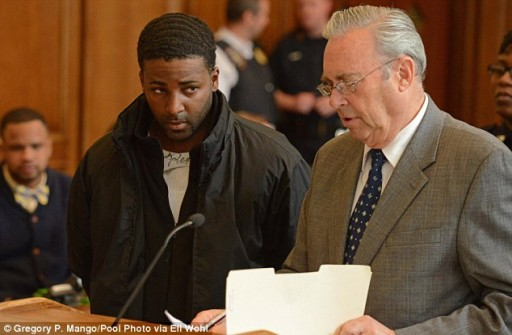 Kendel Felix (pictured left in court May 1 2014) is arraigned for the murder of Menacham Stark in Brooklyn Criminal Court. AP