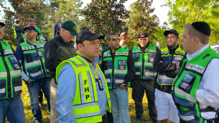 Mark Rosenberg, director of Florida's Chesed Shel Emes and a chaplain for the Florida Highway Patrol with a group of volunteers who helped in the search and rescue.