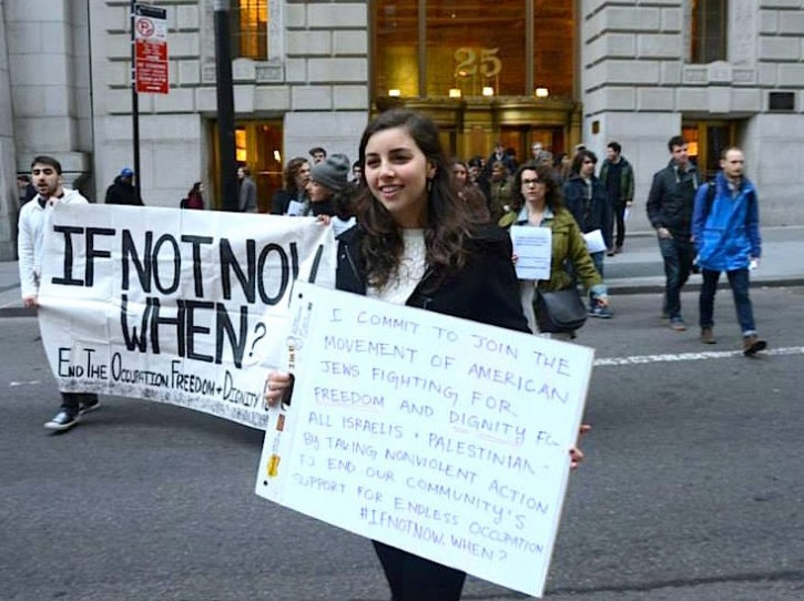 FILE - Zimmerman at IfNotNow demo outside the office of the Conference of Presidents of Major American Jewish Organizations on July 25, 2014 reading the Mourner's Kaddish and the names of the Israeli and Palestinian victims of the 2014 Gaza War protesting their support for the war and ongoing occupation.
