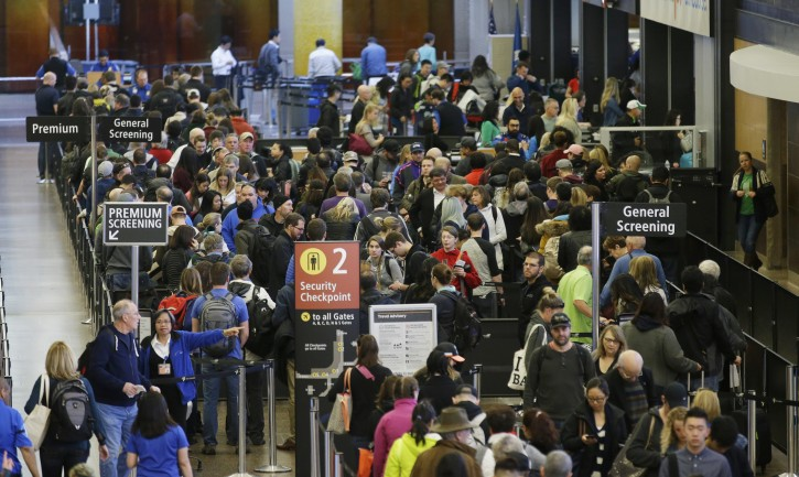 FILE - In this March 17, 2016, file photo, travelers wait in line for security screening at Seattle-Tacoma International Airport in Seattle.  (AP Photo/Ted S. Warren, File)