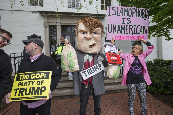 Anti-Trump protesters demonstrate against the GOP's presumptive presidential nominee at the entrance of the Republican National Committee Headquarters on Capitol Hill in Washington, Thursday, May 12, 2016, as Donald Trump meets with Speaker of the House Paul Ryan, R-Wis.  (AP Photo/J. Scott Applewhite)