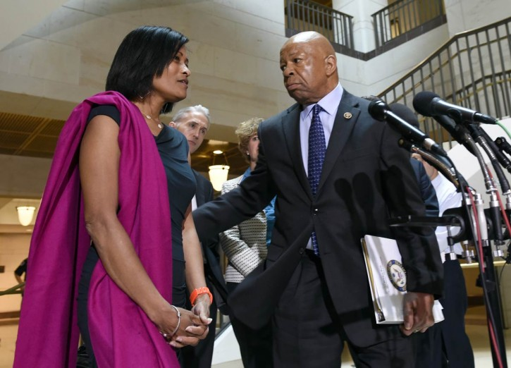 FILE - Former Hillary Rodham Clinton aide Cheryl Mills, left, is directed to the microphones to speak to reporters by House Select Committee on Benghazi ranking member Rep. Elijah Cummings, D-Md., right, as Chairman Trey Gowdy, R-S.C., second from left, watches, on Capitol Hill in Washington, Thursday, Sept. 3, 2015, following her deposition before the panel investigating Benghazi. (AP Photo/Susan Walsh)