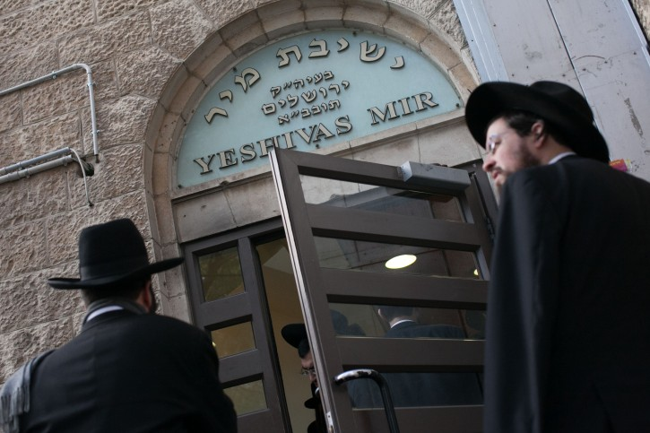 FILE - Yeshiva students stand outside the Mir Yeshiva in the neighborhood of mea shearim, Jerusalem, January 23, 2013. Photo by Yonatan Sindel/Flash90