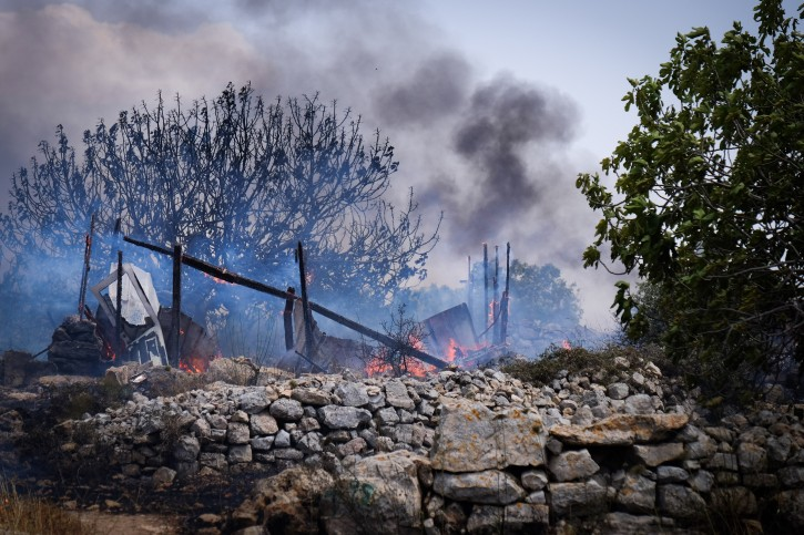 Fire fighters put out a fire in a the forest named after Yaakov Don, who was murdered in a terror attack, near the Jewish settlement of Alon Shvut, in Gush Etzion, on May 26, 2016. Photo by Gershon Elinson/Flash90