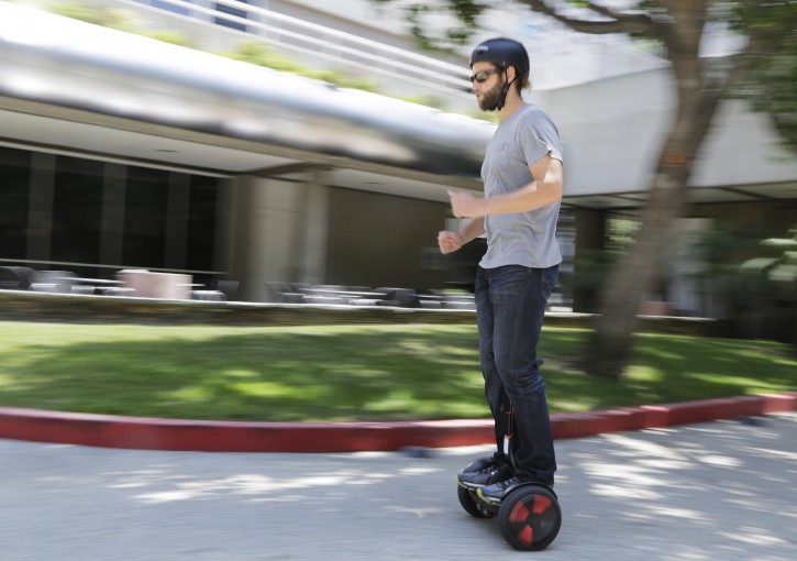 In this May 27, 2016, photo, company representative Zach Servideo demonstrates Segway's new self-balancing scooter, the MiniPro, in downtown Los Angeles. The MiniPro is going on sale on Amazon, Wednesday, June 1, 2016. Hoverboards are attempting a comeback in the U.S., months after videos showing them bursting into flame went viral. (AP Photo/Reed Saxon)