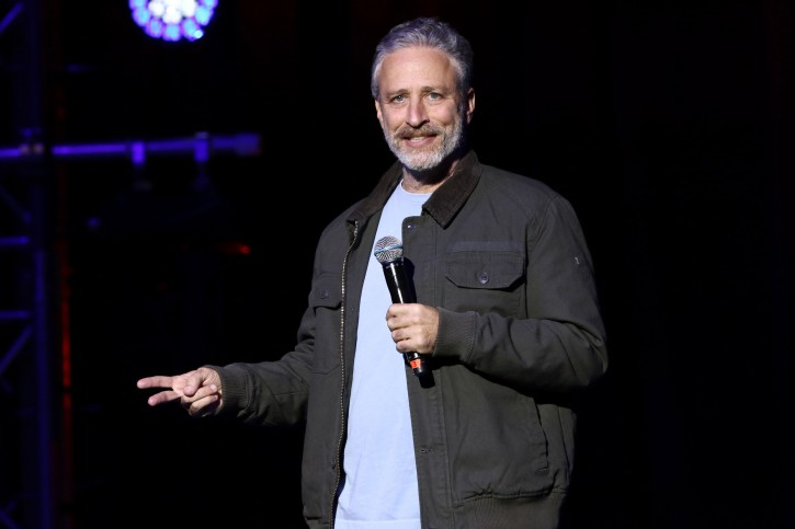 "FILE - In this Tuesday, Nov. 10, 2015, file photo, comedian Jon Stewart performs at the 9th Annual Stand Up For Heroes event, in New York. During a taping of a podcast with President Barack Obama's former aide on Monday, May 9, 2016, Stewart described presumptive Republican presidential nominee Donald Trump as a ""man-baby.""(Photo by Greg Allen/Invision/AP, File)"