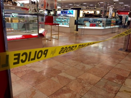 Crime scene tape is seen inside the Macy's at the Silver City Galleria mall in Taunton, Mass., Tuesday, May 10, 2016. Multiple people have been stabbed separate attacks at the mall and a home in Massachusetts. (Charles Winokoor/The Daily Gazette via AP)