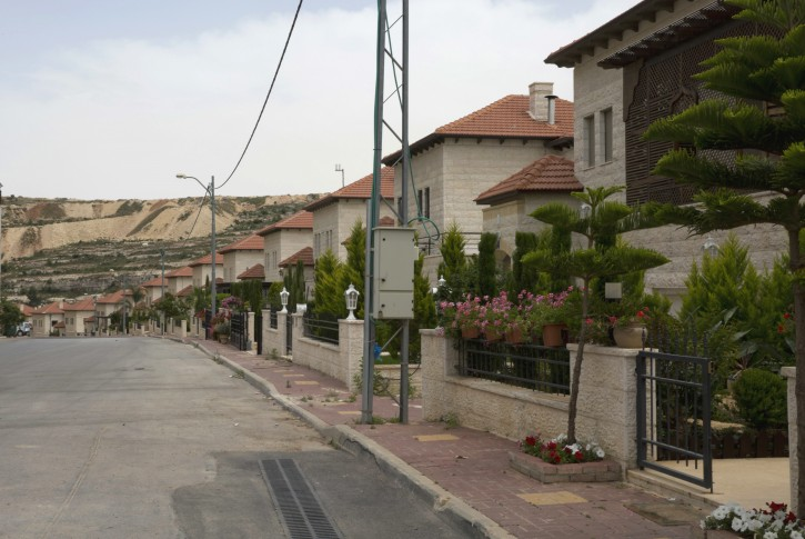 In this photo made Monday, May 9, 2016, a line of villas is seen in the Palestinian Diplomatic Neighborhood at the outskirts of the West Bank city of Ramallah. A new poll signals that virtually all Palestinians in the West Bank now believe there is corruption in the government of President Mahmoud Abbas. This astounding collapse of public faith may in part be an expression of a broader hopelessness as the Palestinians enter their 50th year under Israeli military occupation. (AP Photo/Nasser Nasser)