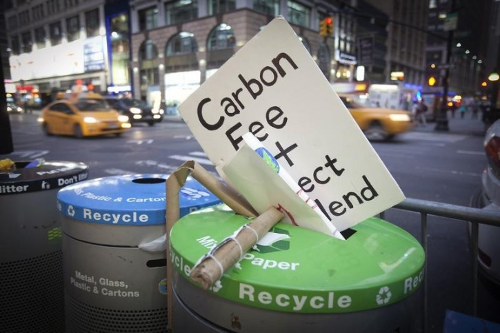 "FILE - A sign that had been carried during the ""People's Climate March"" is discarded into the trash after the march in the Manhattan borough of New York September 21, 2014. Reuters"