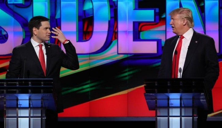 FILE - Republican U.S. presidential candidates Donald Trump (R) and Marco Rubio talk at each other during a debate sponsored by CNN at the University of Miami in Miami, Florida, March 10, 2016.    REUTERS/Carlo Allegri