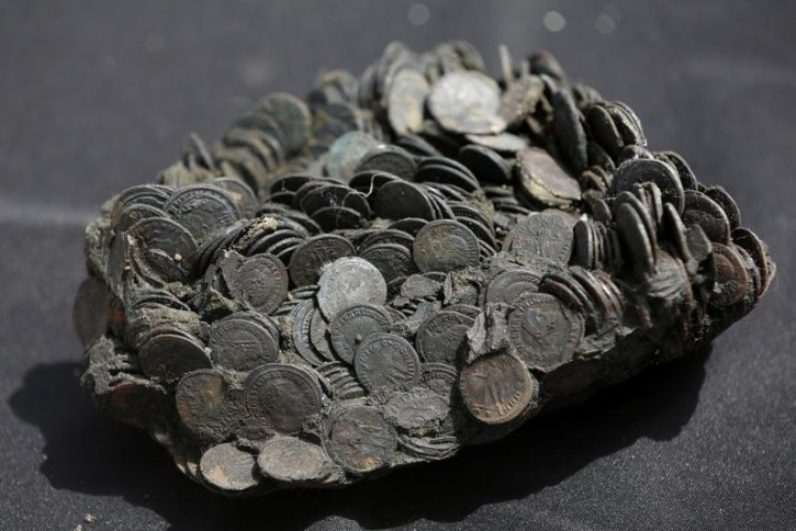 Coins, which the Israel Antiquities Authority (IAA) estimates to be around 1600 years old, are displayed after they were recovered from a merchant ship in the ancient harbor of the Caesarea National Park May 16, 2016. REUTERS/ Baz Ratner