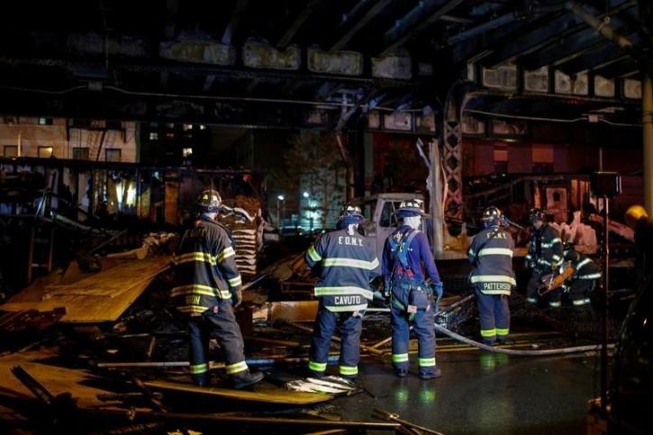 FILE - New York Fire Department members attend to a fire call at the Harlem neighborhood in New York May 17, 2016.REUTERS