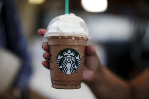 FILE - A woman holds a Frappuccino at a Starbucks store inside the Tom Bradley terminal at LAX airport in Los Angeles, California, United States, October 27, 2015. REUTERS