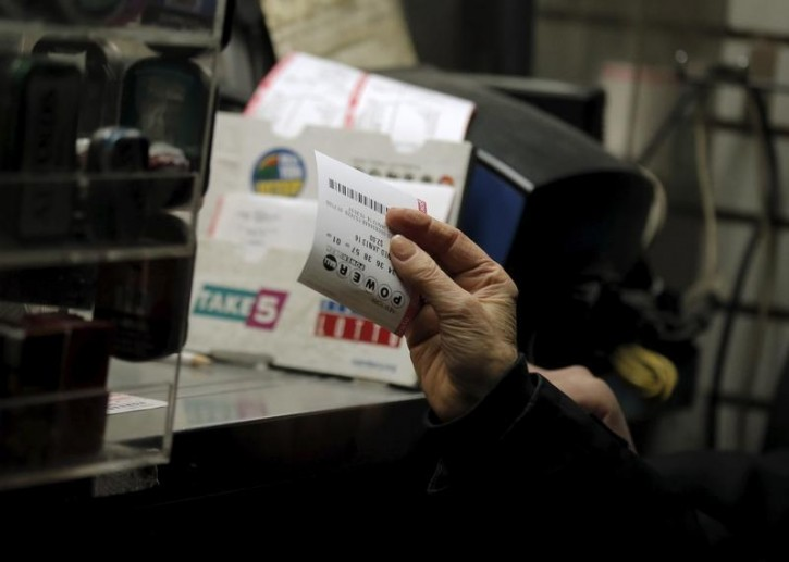FILE - A customer purchases a Powerball lottery ticket at a news stand on Wall St. in New York January 13, 2016. Reuters