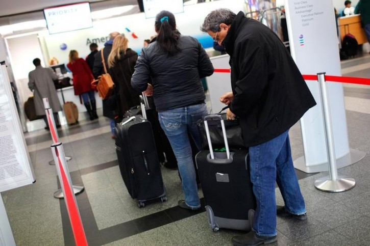 FILE - Travelers check in for departing flights at New York's Laguardia Airport ahead of a powerful approaching winter storm January 22, 2016. REUTERS/Mike Segar