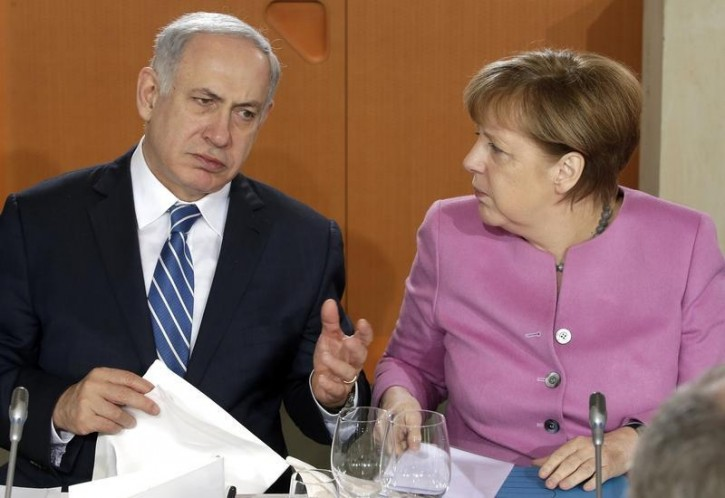 FILE - German Chancellor Angela Merkel and Israeli Prime Minister Benjamin Netanyahu speak before a lunch as part of a one day governmental meeting at the Chancellery in Berlin, Germany, February 16, 2016.        REUTERS/Michael Sohn/Pool