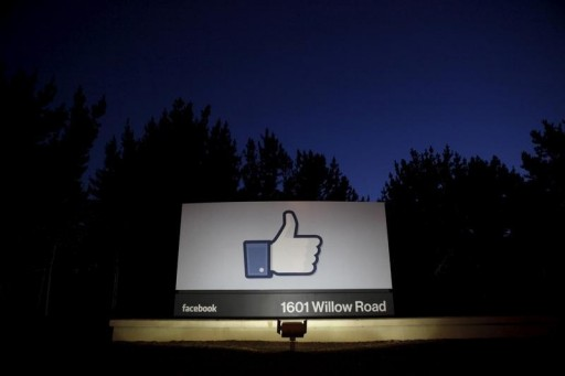 FILE - The sun rises behind the entrance sign to Facebook headquarters in Menlo Park before the company's IPO launch, May 18, 2012.  REUTERS/Beck Diefenbach/File Photo