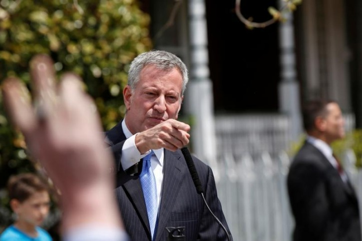 FILE - New York Mayor Bill de Blasio gestures during a media briefing in Brooklyn, New York, U.S., April 25, 2016. REUTERS/Shannon Stapleton