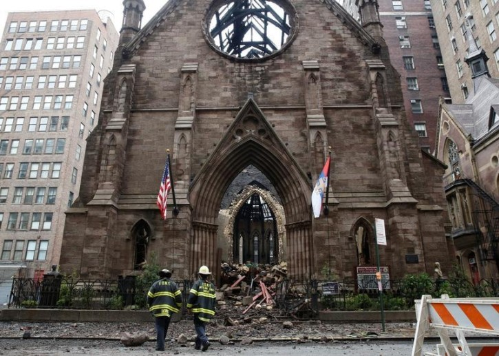 New York City firefighters (FDNY) walk through the debris following a fire at Manhattan's historic Serbian Orthodox Cathedral of Saint Sava in New York City, U.S., May 2, 2016.  REUTERS/Brendan McDermid