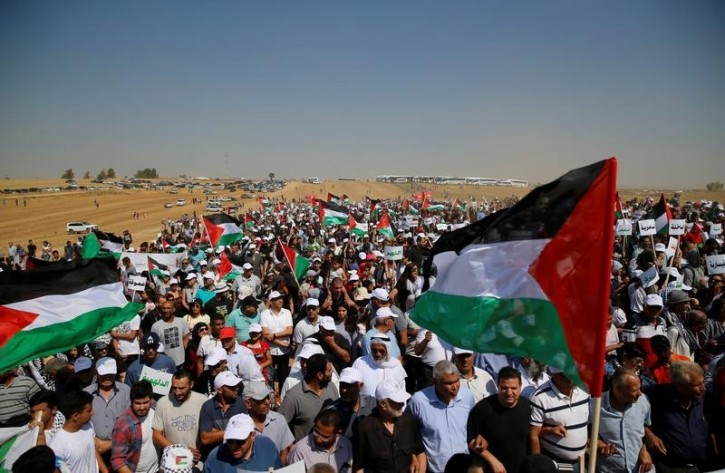 Israeli Arabs and other supporters wave Palestinian flags as they march during a protest to mark the right of return for refugees who fled their homes during the 1948 ArabÐIsraeli War, at a village near Rahat in southern Israel, May 12, 2016. The 1948 war followed the creation of Israel, which marks its 68th Independence Day this year. REUTERS/Ammar Awad