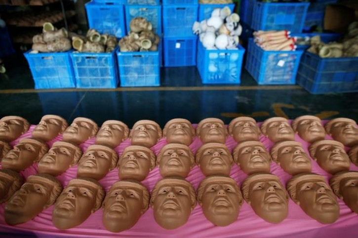 """Masks of U.S. Republican presidential candidate Donald Trump are seen at Jinhua Partytime Latex Art and Crafts Factory in Jinhua, Zhejiang Province, China, May 25, 2016. There's no masking the facts. One Chinese factory is expecting Donald Trump to beat his likely U.S. presidential rival Hilary Clinton in the popularity stakes. At the Jinhua Partytime Latex Art and Crafts Factory, a Halloween and party supply business that produces thousands of rubber and plastic masks of everyone from Osama Bin Laden to Spiderman, masks of Donald Trump and Democratic frontrunner Hillary Clinton faces are being churned out. Sales of the two expected presidential candidates are at about half a million each but the factory management believes  Trump will eventually run out the winner. """"Even though the sales are more or less the same, I think in 2016 this mask will completely sell out,"""" said factory manager Jacky Chen, indicating a Trump mask. REUTERS/Aly Song"""