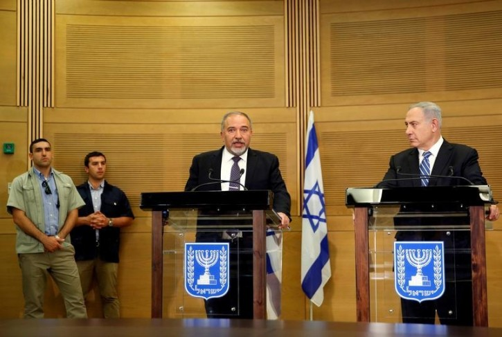Israeli prime minister Benjamin Netanyahu (R) listens as Israel's new Defence Minister Avigdor Lieberman, head of far-right Yisrael Beitenu party, speaks during a media conference following Lieberman's swearing-in ceremony at the Knesset, the Israeli parliament, in Jerusalem May 30, 2016. REUTERS/Ronen Zvulun