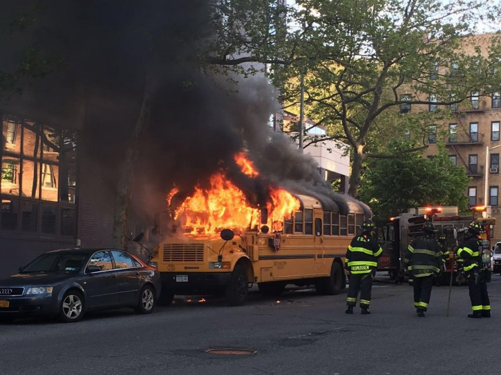 As many as five boys were on the parked bus when the boy lit the fire just after 6 p.m. on Sunday ( Photo: CrownHeights.info)