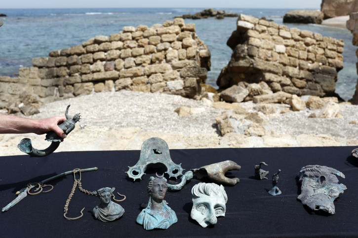 Some of the archeological finds are on display at the ancient port of Caesarea, Israel, 16 May 2016. Israeli divers found an ancient marine cargo in a merchant shipwreck that sank during the Late Roman period 1,600 years ago at the Caesarea National Park seabed.  Hundreds of coins and statues from the  Roman period were discovered.  EPA/ABIR SULTAN
