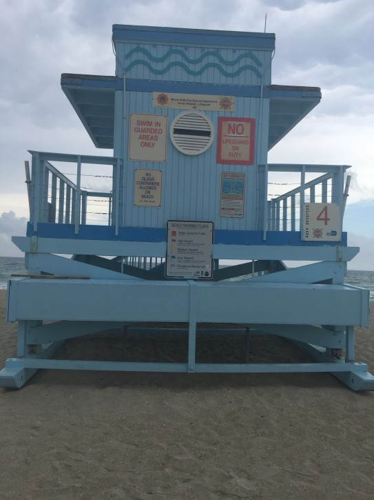 Haulover Beach's Tower 4, located at the scene of today's drownings, advising swimmers only to swim in areas where lifeguards are present