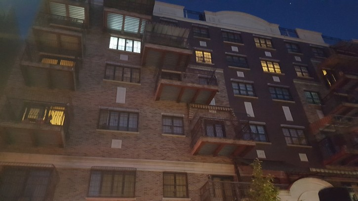 200 Wallabout Street in Williamsburg - Balcony to the left of the bright white window lights (. Roy Renna/VINnews.com)