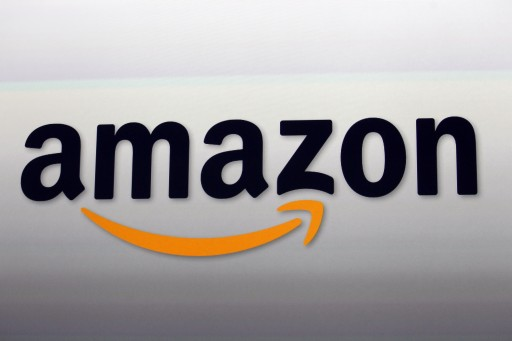 FILE - This Sept. 6, 2012, file photo, shows the Amazon logo in Santa Monica, Calif. Amazon is taking on Netflix and Hulu with a stand-alone video streaming service. Starting the week of April 18, 2016, customers can pay $8.99 a month to watch Amazon's Prime video streaming service.  (AP Photo/Reed Saxon, File)