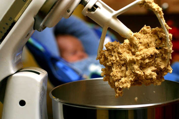 FILE - In this undated file photo, cookie dough clings to the beaters of a standing mixer. The Food and Drug Administration issued a warning on June 28, 2016, that people shouldn't eat raw dough due to an ongoing outbreak of illnesses related to a strain of E. coli bacteria found in some batches of flour.  (AP Photo/Larry Crowe, File)