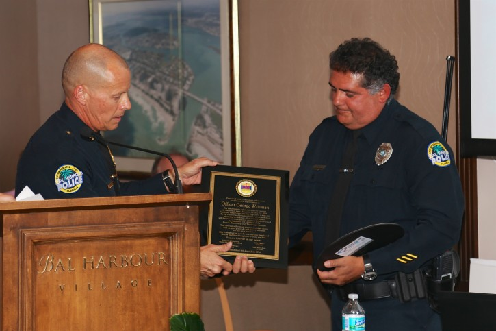 Chief Overton of the Bal Harbour PD. giving the award to Officer George Waisman.