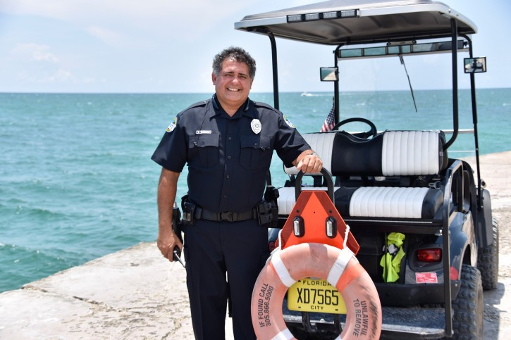 On June 15, 2016 Bal Harbour police officer George Waisman standing next to a rescue vehicle at the location where the drowning occurred. (Michele Sandberg /VINnews.com)