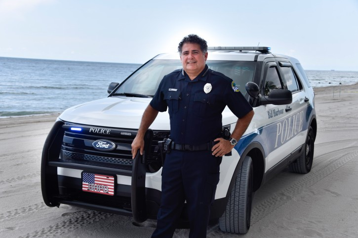 On June 15, 2016 Bal Harbour police officer George Waisman standing with his patrol vehicle at the location where the drowning occurred. (Michele Sandberg /VINnews.com)