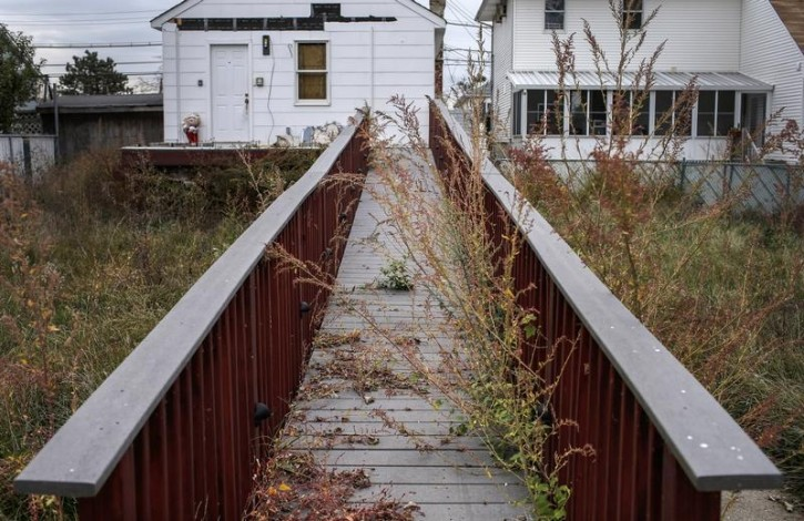 FILE - An overgrown walkway leads to an abandoned home on Staten Island in New York City October 23, 2013. REUTERS