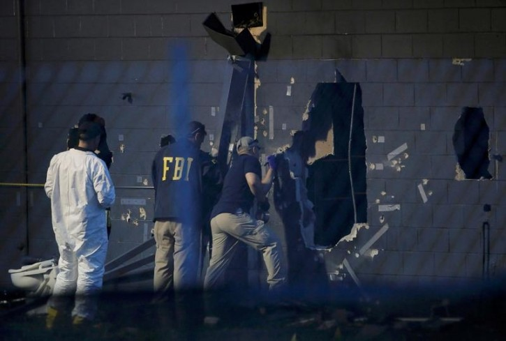 Police forensic investigators work at the crime scene of a mass shooting at the Pulse gay night club in Orlando, Florida, U.S. June 12, 2016.   REUTERS/Jim Young
